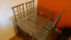 Glass dining table (open to sensible offers)
