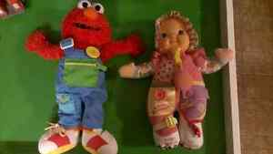 Teach Me Elmo and/or baby girl doll. $5 each.