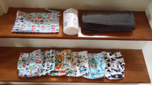 Cloth diaper covers, inserts, and bag (brand new - never used)