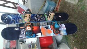 2 GNU SNOWBOARDS each with bindings