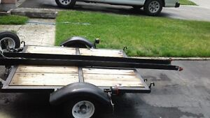 motorcycle, drive up trailer.