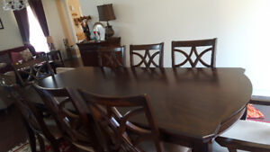 New nice dinning table(wood adjustable)with  8 chairs