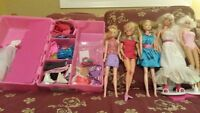 5 Barbie Dolls, extra Clothing,and Carring Case