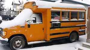 1995 20 passenger bus used for hauling and moving.