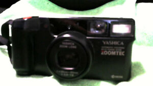 YASHICA CAMERA, ZOOM LENS AUTOMATIC FOCUSING 23X POWER ZOOM