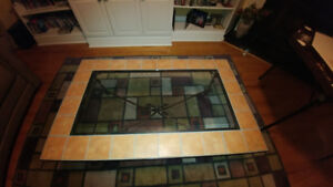 terra cotta tile and glass coffee table with two end tables