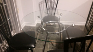 Modern glass table with 4 chairs