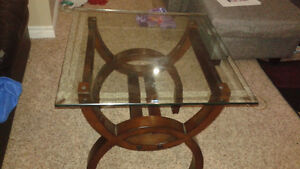 2 brown and glass end tables