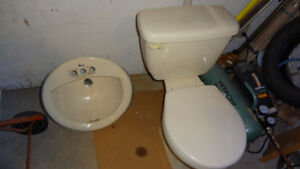 Porcelain toilet and sink, bone.