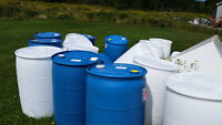 Blue and white plactic 45 gallon barrels
