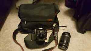 Canon Rebel DSLR w/ 18-55mm lens,camera bag, Canon 55-250mm lens