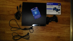 PS3 for sale includes gift card and several games