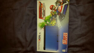 Nintendo 3DS XL plus accessories.