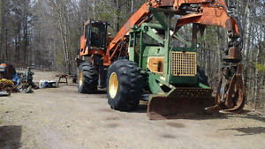 Skidder with tree farmer and slasher