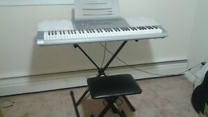 CASIO GREY KEYBOARD WK-225. WITH POWER SUPPLY. GOOD CONDITION.