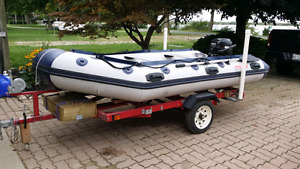 NEW PRICE! 12' inflatable boat with 10 hp motor and trailer
