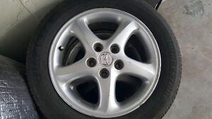 4 pneus d'été Bridgestone 205/55 R16 sur jantes