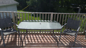 Sold pending pickup - Glass Top Patio Table with 2 chairs
