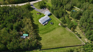 LAKESIDE ACREAGE WITH BOAT SLIP COSE TO RED DEER!