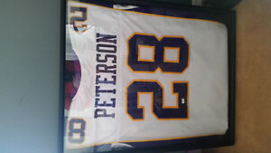 Autographed Adrian Peterson Jersey with glass case