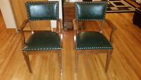 Wooden Chairs with green leather.