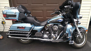 Trade 2007 Harley Ultra Classic plus cash for property