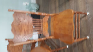 Oak table and 4 oak press back chairs