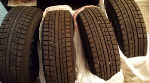 4 Yokohama Snow Tires (185/65R15) and Rims (4 X 100mm)