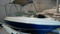 1994 GW Invader Bravo bowrider boat with double axle trailer
