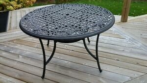48''brushed bronze finish patio table. (new 2015) + 4 chairs