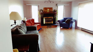 Large bedroom with attached private half bathroom in Maple Creek