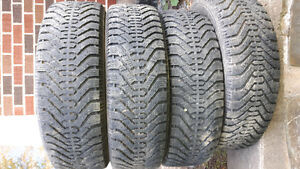 set of four 215/65r16 goodyear winter tires for sale.   lots of