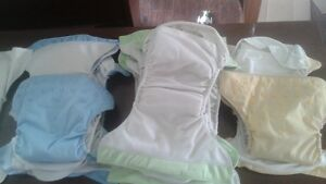 14 cloth diapers and 2 travel wet bags