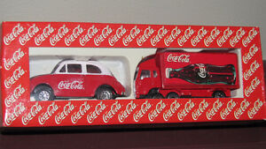 From Belgium two Coca-Cola diecast vehicles