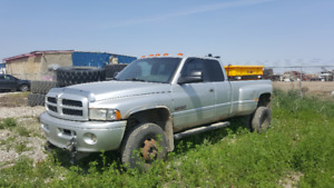 2002 Dodge Ram 3500 with canopy cover and Western Pro Plow