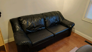 Black leather couch - good condition