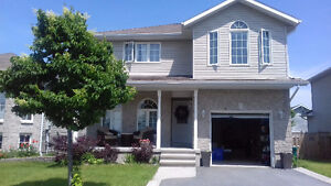 Aug. 15: Cataraqui Woods-- 4 bedroom house for rent