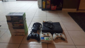 XBOX 360 Slim (250GB HDD). 3 Wireless Controllers. 20 Games.