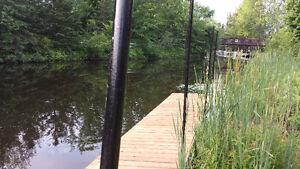 Magog dans un duplex, grand 4 1/2 au bord de l'eau et accès dire
