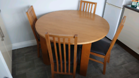 Table and 4 chairs. Good solid table.