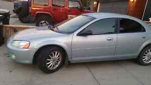 2003 Chrysler Sebring- includes one season old winter tires