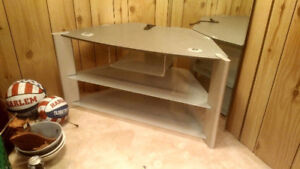 Silver TV stand with 3 glass shelves