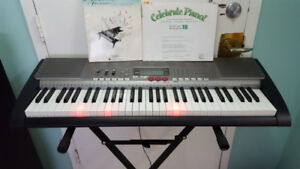 Casio keyboard LK230 with  key lights + Stand and book