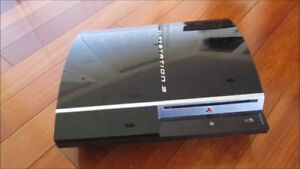 PLAYSTATION 3 WITH 2 CONTROLLERS & 8 GAMES