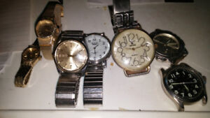 7-QUARTZ WATCHES.  ALL FOR 20.00. THEY ALL TAKE BATTERYS