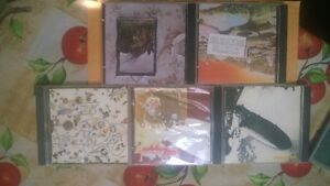 31 rock cd's and Rush R30 deluxe ed + cd stand, paid 70$ for