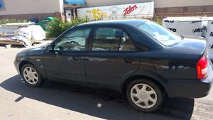 2003 Mazda Protege trade for a 4x4