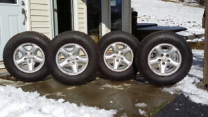 """Jeep 15"""" Rims with Winterforce 225/75R/15 Studded Tires"""