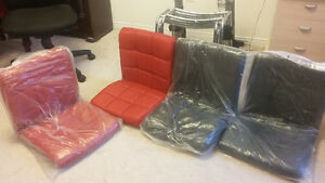 Brand New 4 pic Set of Chairs, never used, 2 red/2black