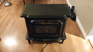 Electric fireplace with heater and fan